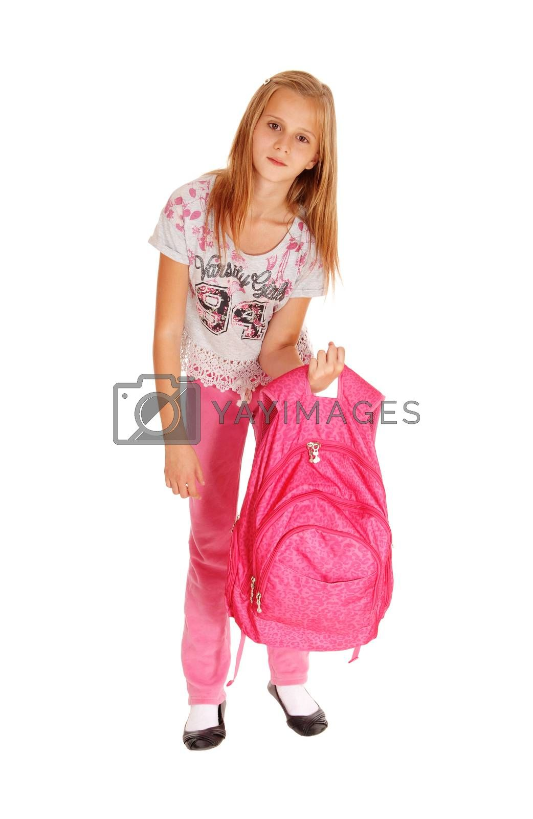 A blond pretty girl lifting her heavy pink backpack for school, standing isolated for white background.