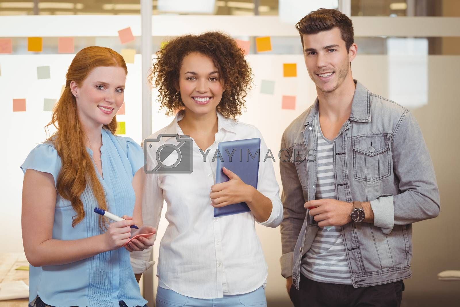 Portrait of confident business people standing in office during meeting