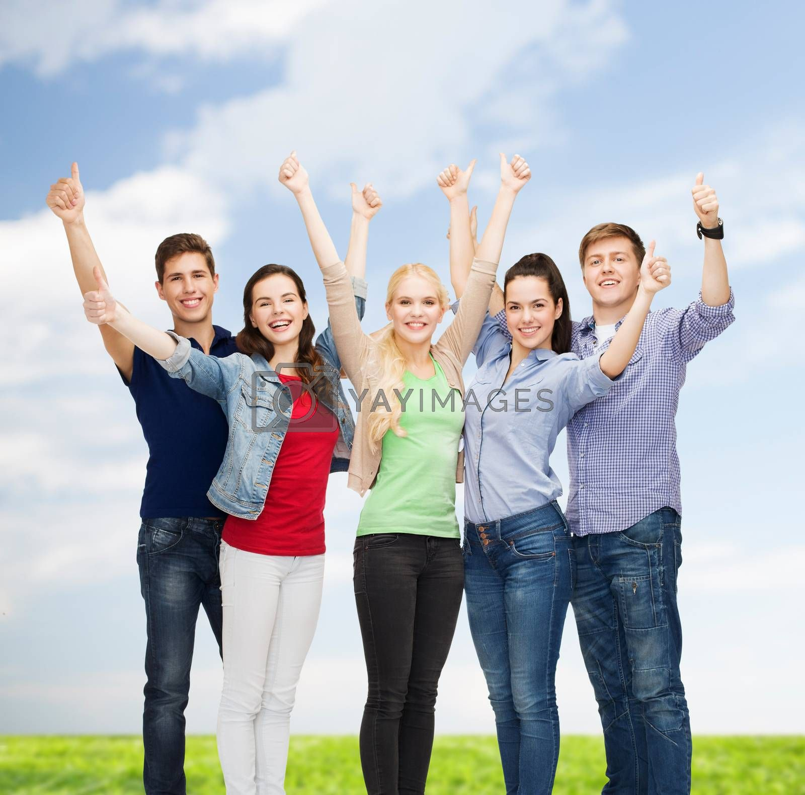 group of smiling students showing thumbs up by dolgachov