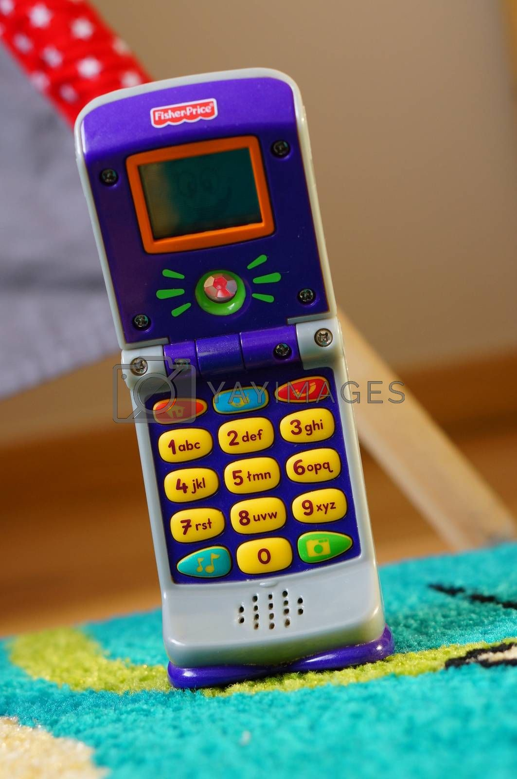 POZNAN, POLAND - AUGUST 20, 2015: Fisher Price plastic toy phone