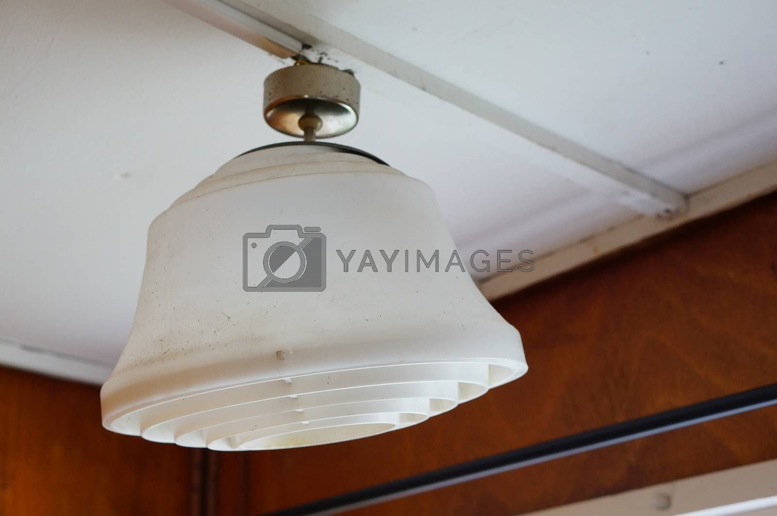 White plastic electric lamp hanging on ceiling