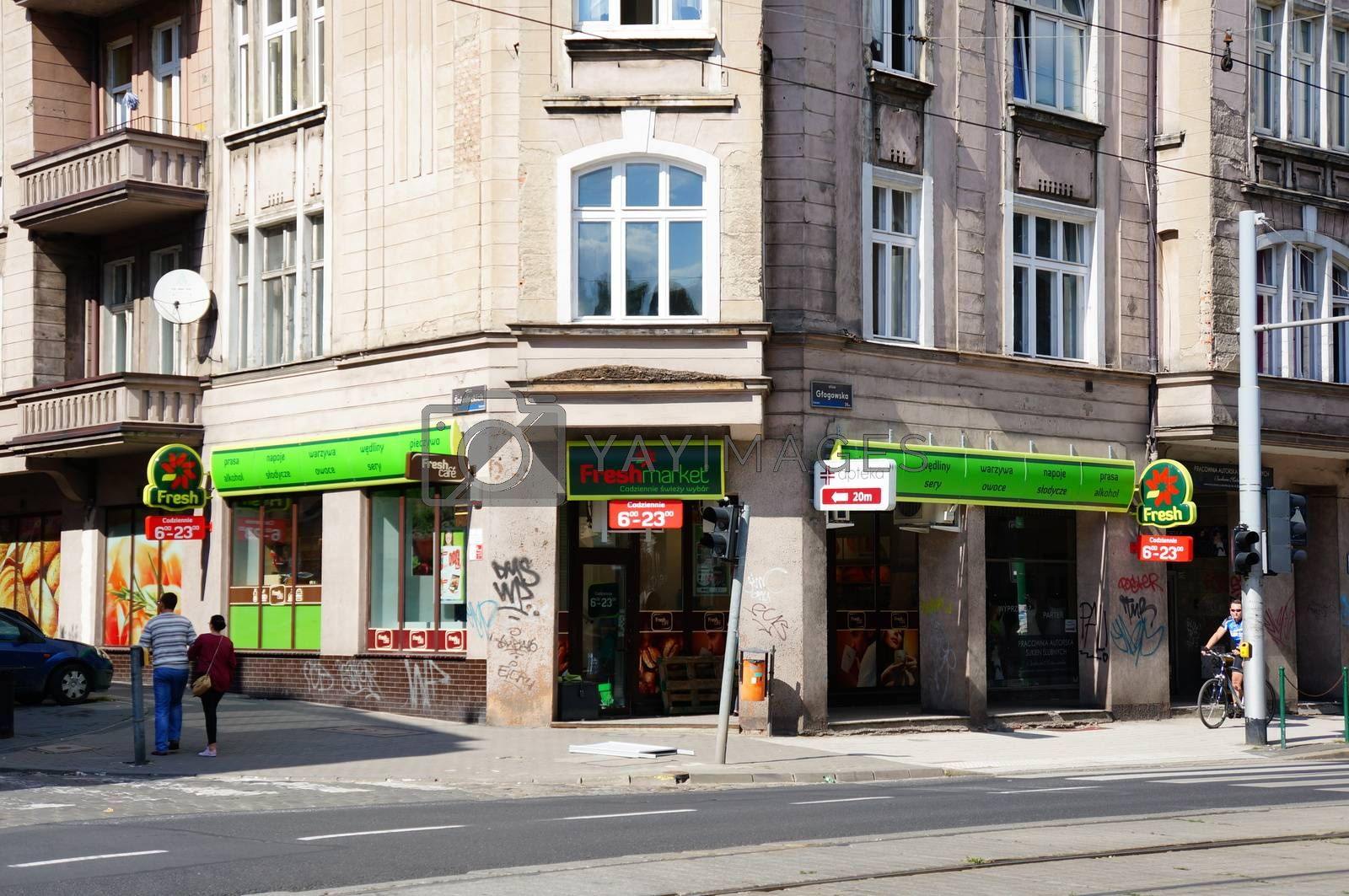 POZNAN, POLAND - AUGUST 25, 2013: Small store at a corner of the Glogowska street