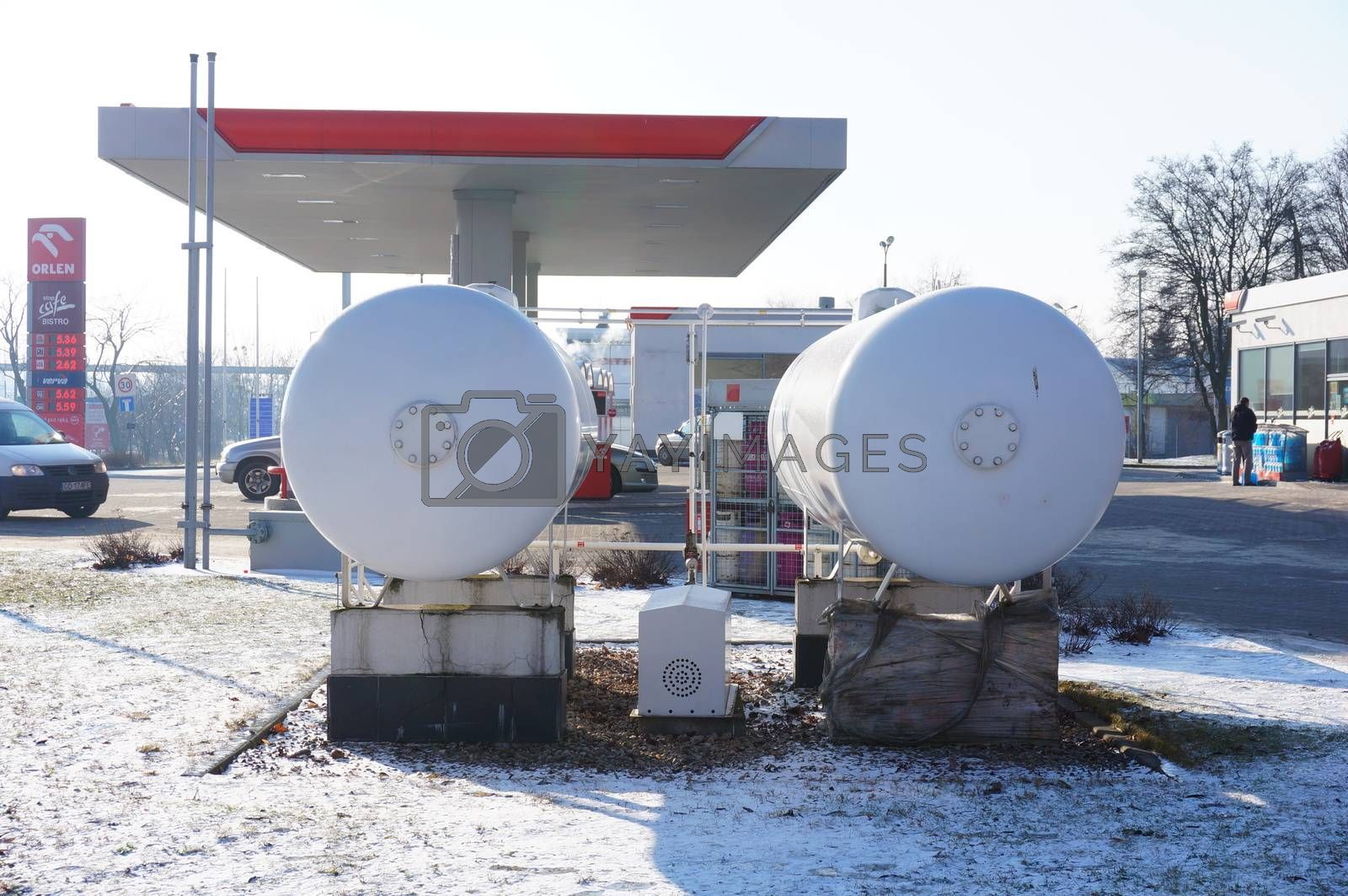 POZNAN, POLAND - JANUARY 25, 2014: Two oil tanks at a Orlen filling station on a cold winter day