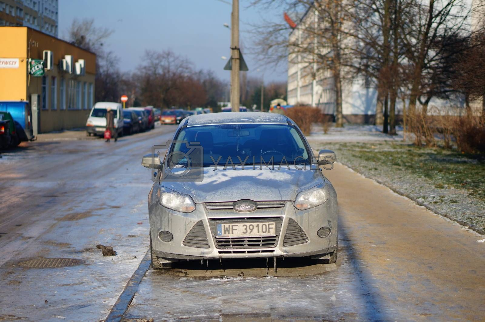 POZNAN, POLAND - JANUARY 25, 2014: Parked car covered with ice on a cold winter day