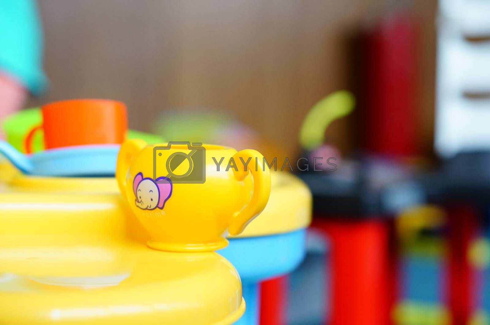 Yellow toy cup with elephant symbol on table