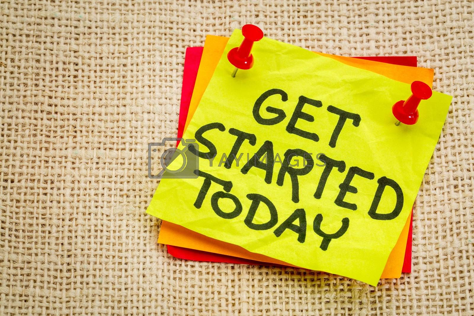 Get started today reminder - handwriting on a sticky note against burlap canvas