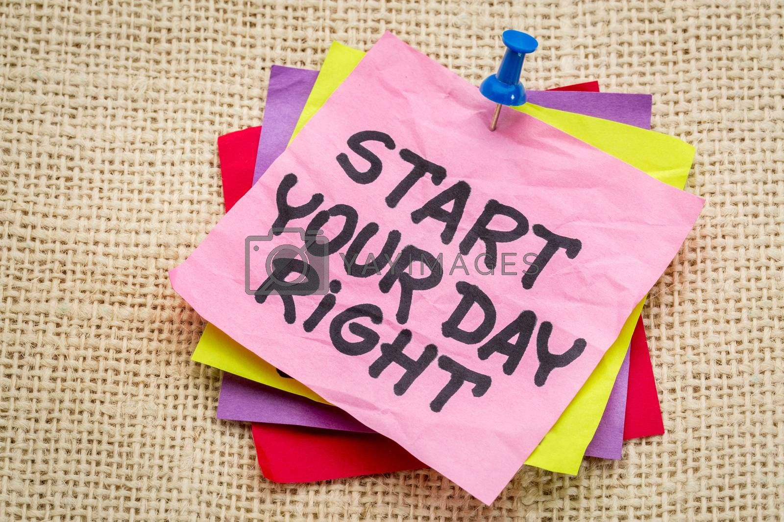 Start your day right reminder - motivational handwriting on a sticky note against burlap canvas