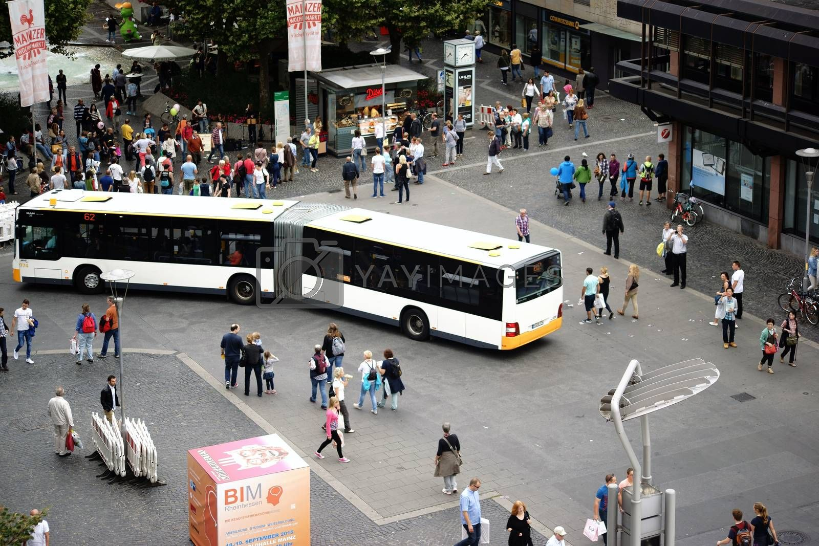 Mainz, Germany - September 11, 2015: Bus routes and groups of people on the Gutenberg square corner Schoeffer Street on September 11, 2015 in Mainz.