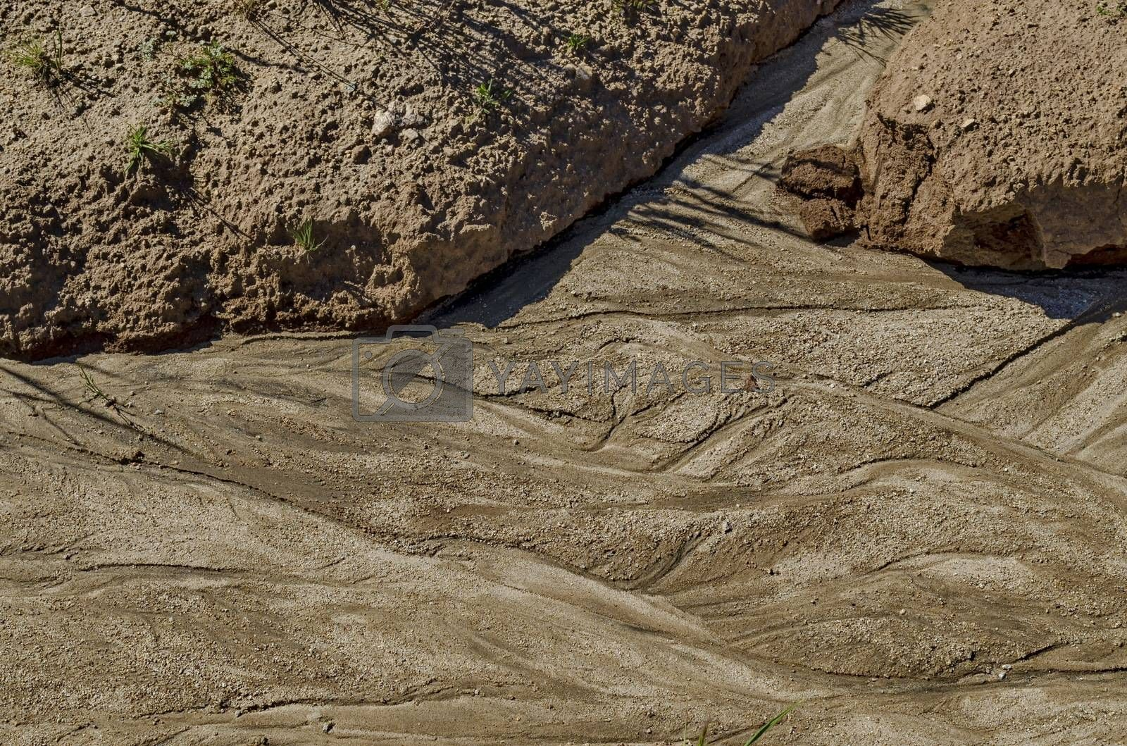 Dry land with drawing after flood rain in the field, Plana mountain, Bulgaria