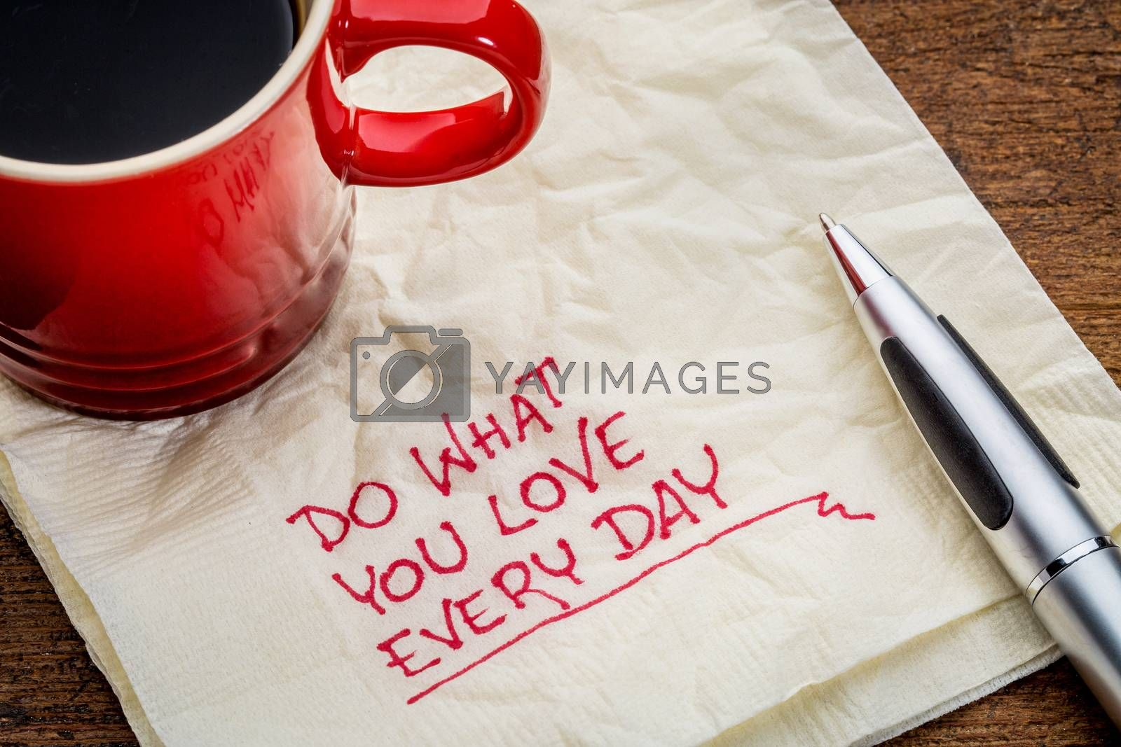 Do what you love every day - inspirational handwriting on a napkin with a cup of coffee