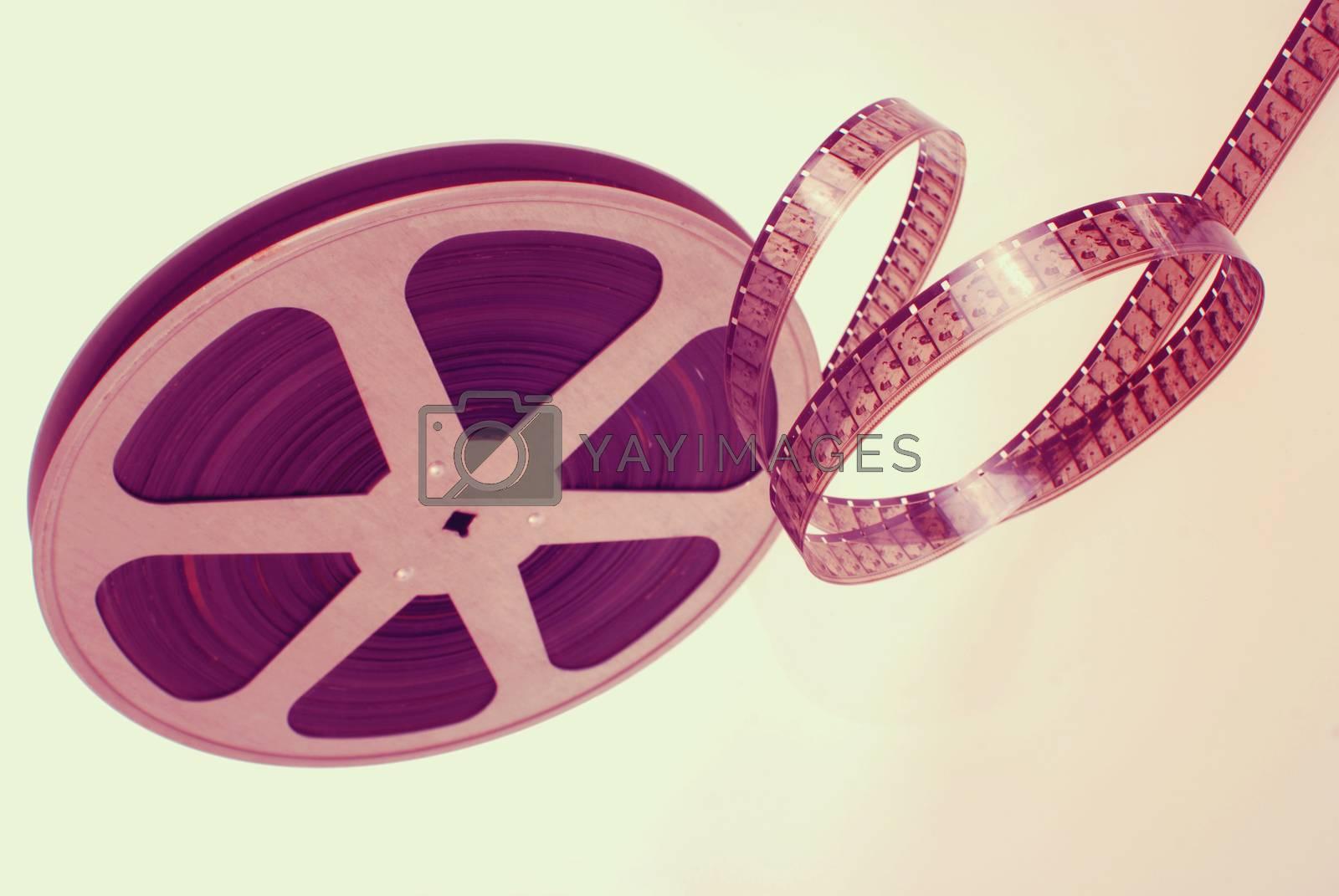 Vintage analogic photographic film strip wheel isolated on white background.