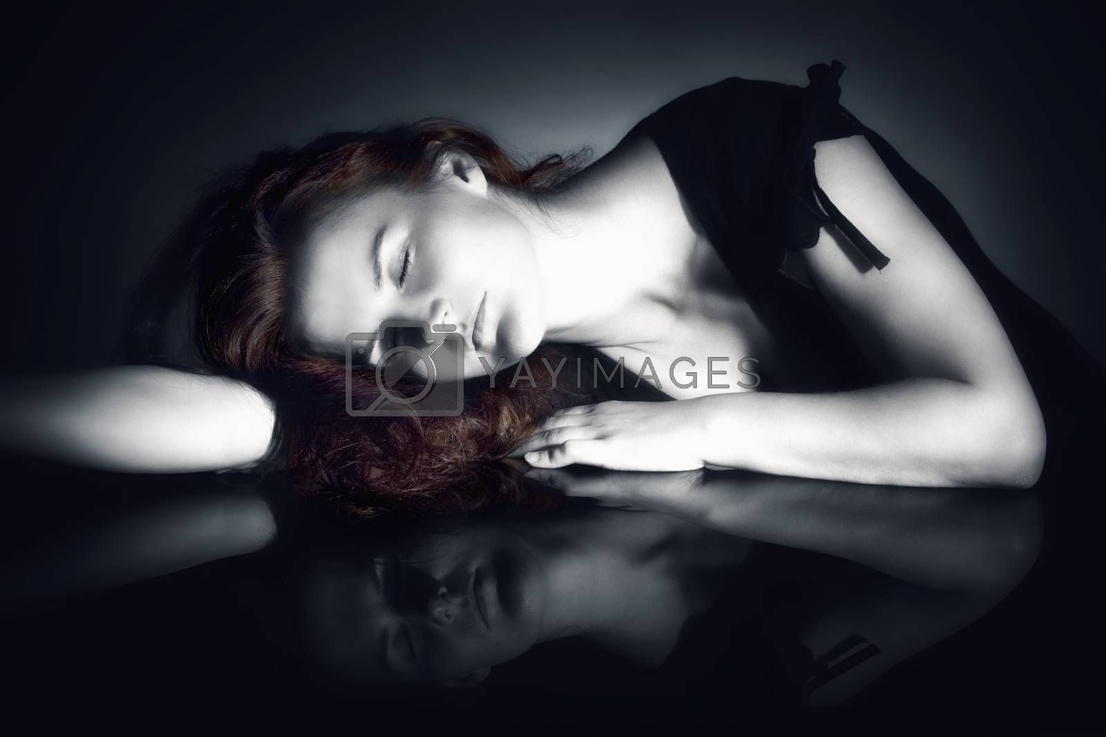 Royalty free image of Woman with Closed Eyes Dreaming by courtyardpix