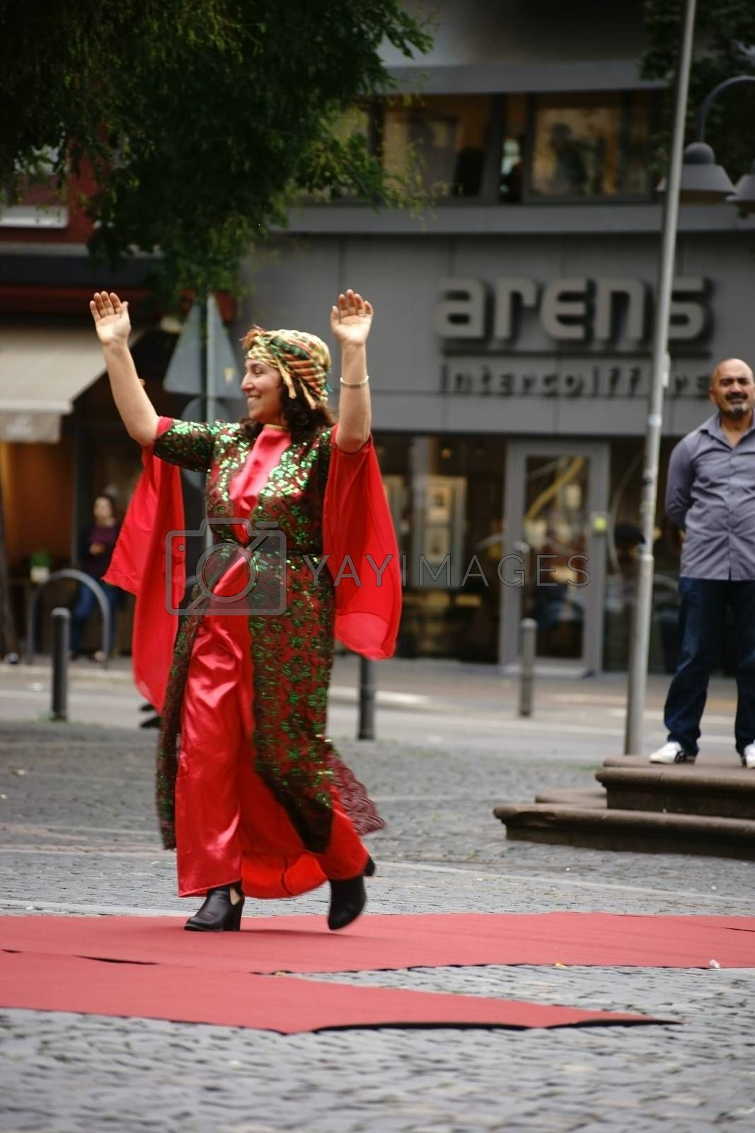 Mainz, Germany - September 25, 2015: A Kurdish woman presenting a colorful traditional costume at an event organized by the Intercultural Weeks on September 25, 2015 in Mainz.