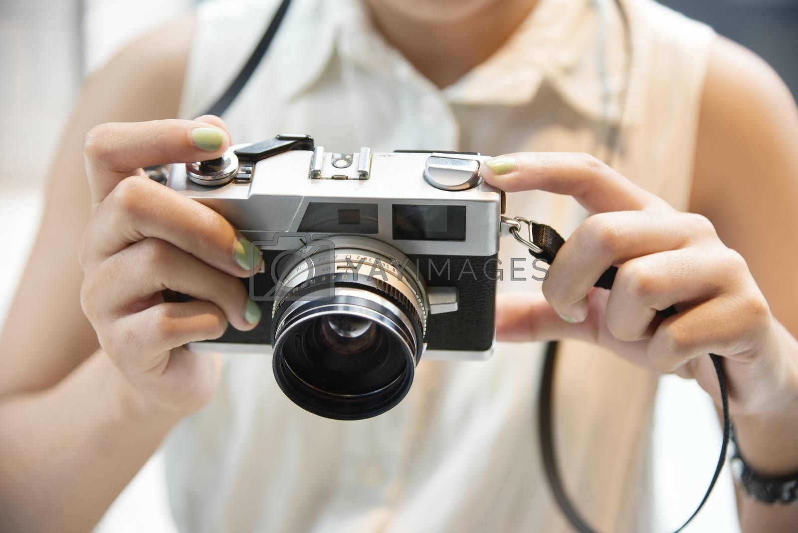 Hipster girl take a photo with vintage camera