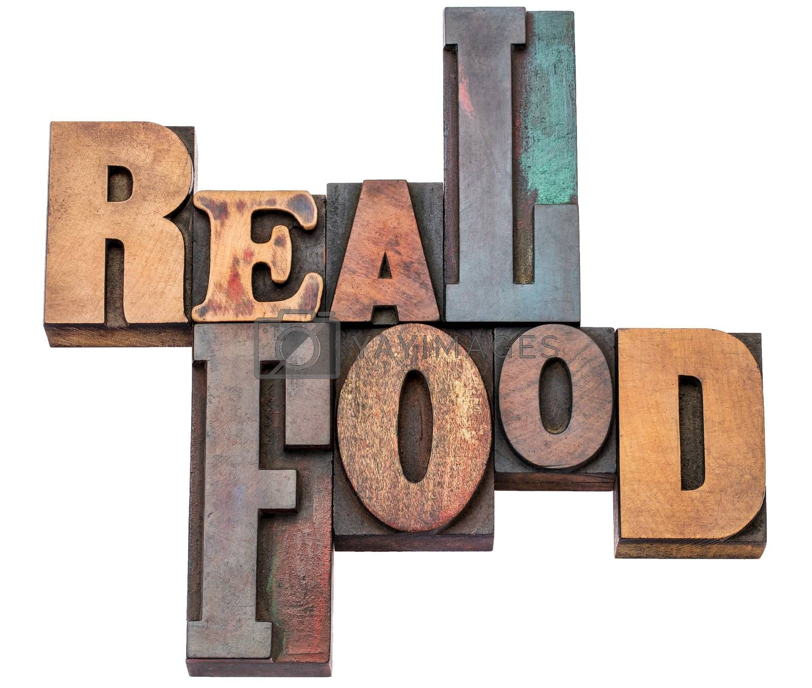 real food word abstract - isolated text in mixed letterpress wood type printing blocks - healthy eating and lifestyle concept