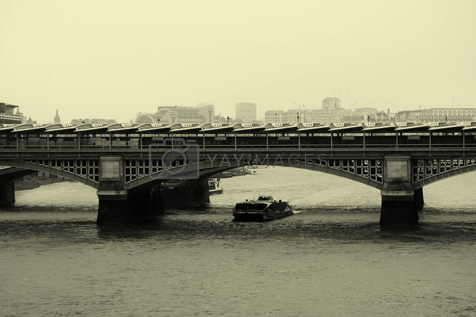 The Blackfriars bridge over the River Thames in London with solar panels on the roof.