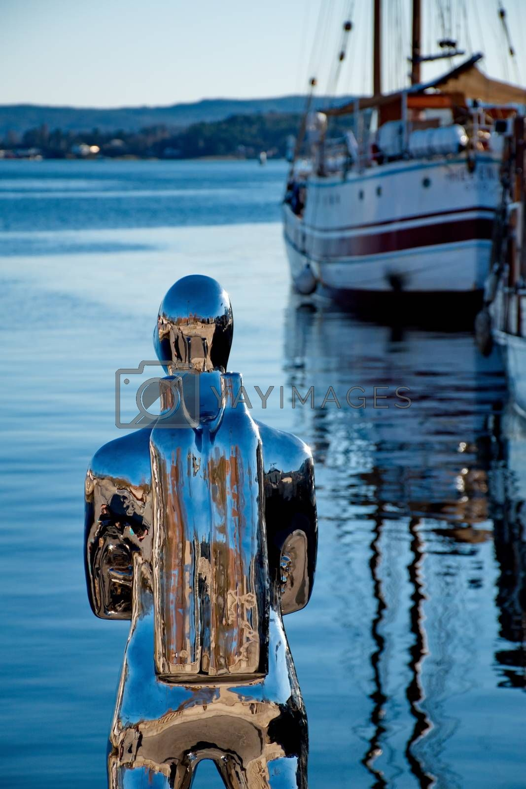 OSLO - MARCH 21: Contemporary scuplture of a diverr in Oslo harbour