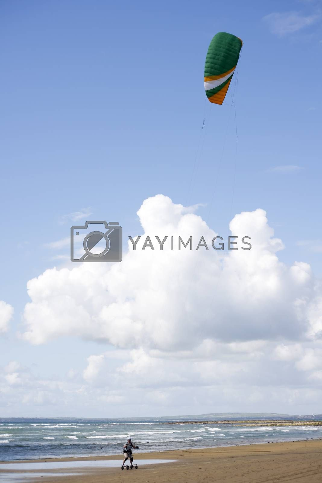 kite boarder on beautiful beach by morrbyte