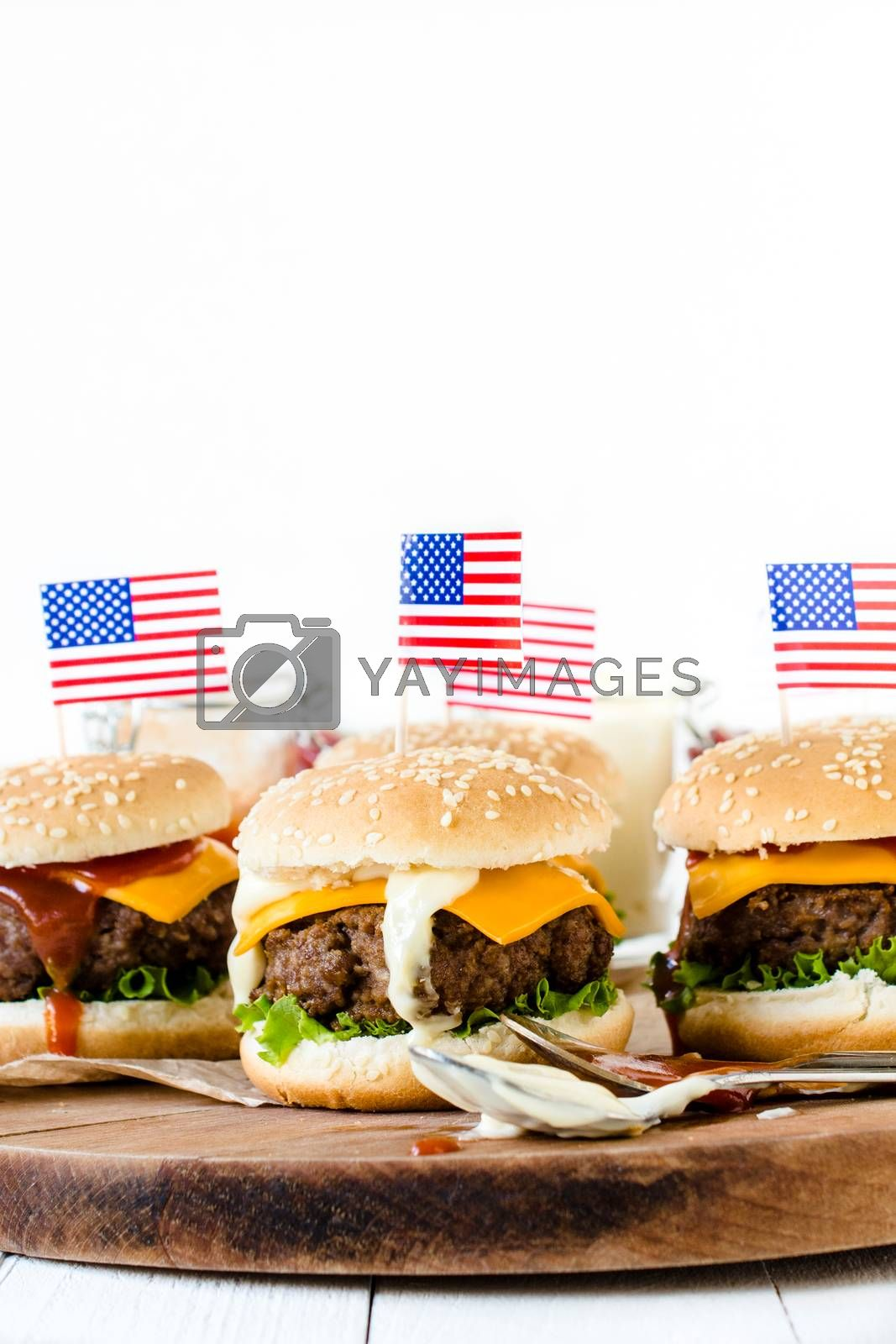 American mini beef burgers with cheese and USA flags,selective focus and blank space