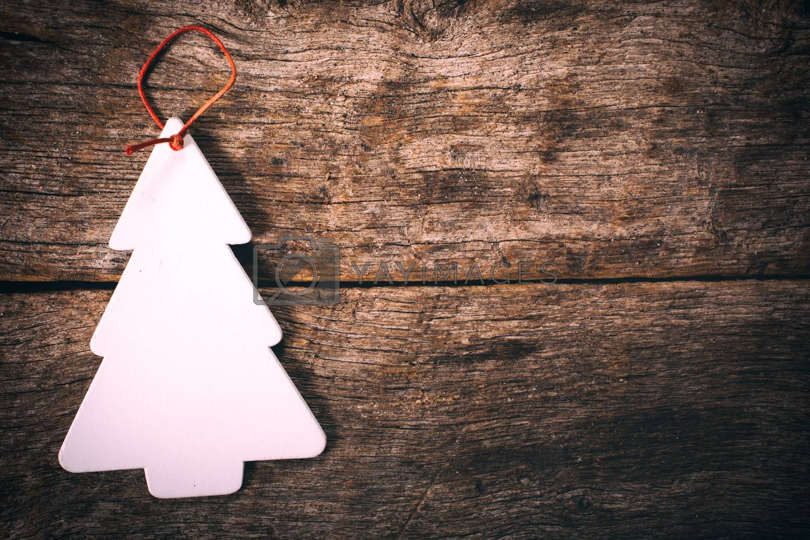 Blank card in shape of Christmas tree on wooden background