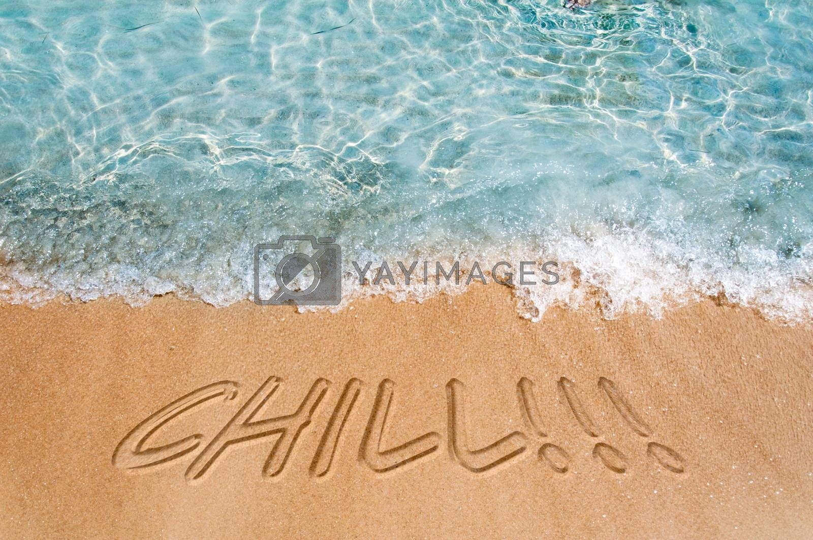 Chill sign on the beach sand
