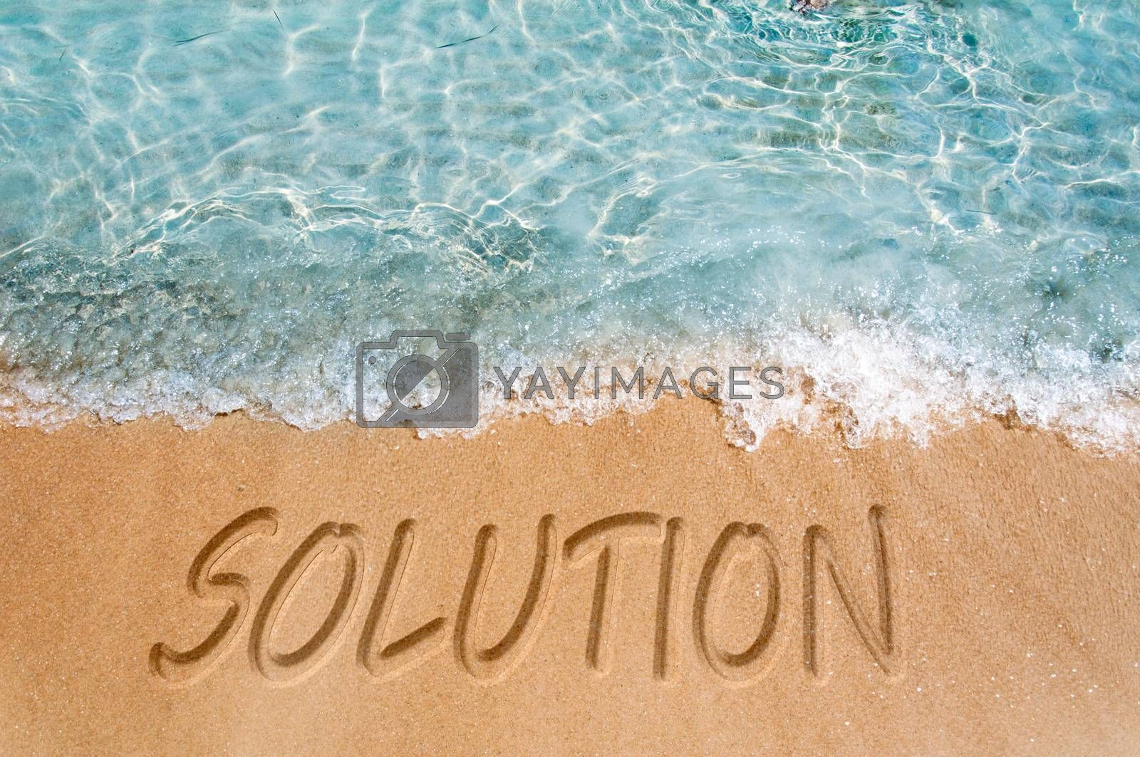 Solution word sign on the beach sand