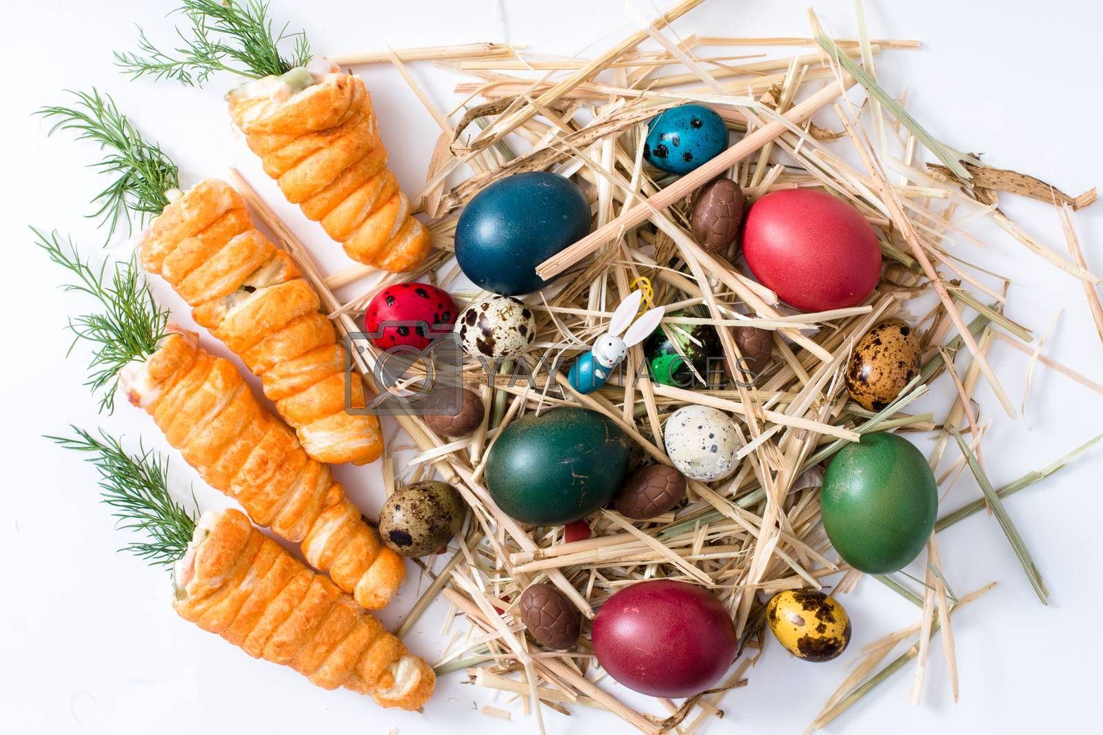 Easter background with eggs,carrot pastry and rabbit