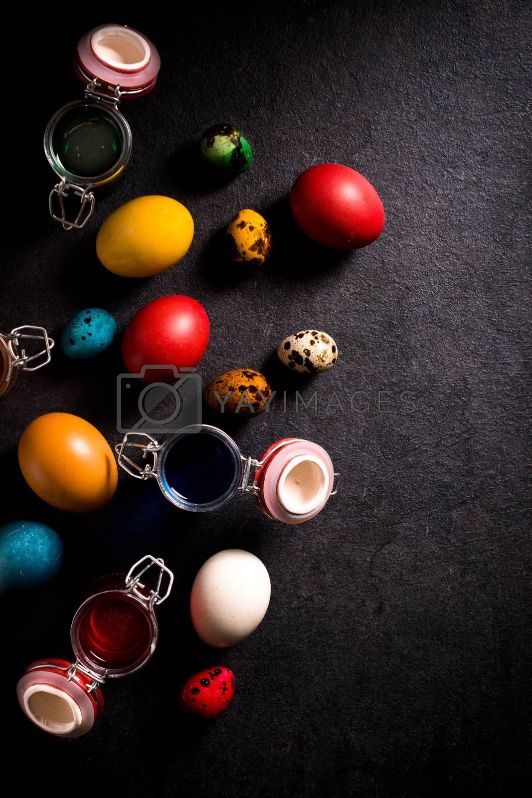 Large group of colorful Easter eggs from above,selective focus and blank space