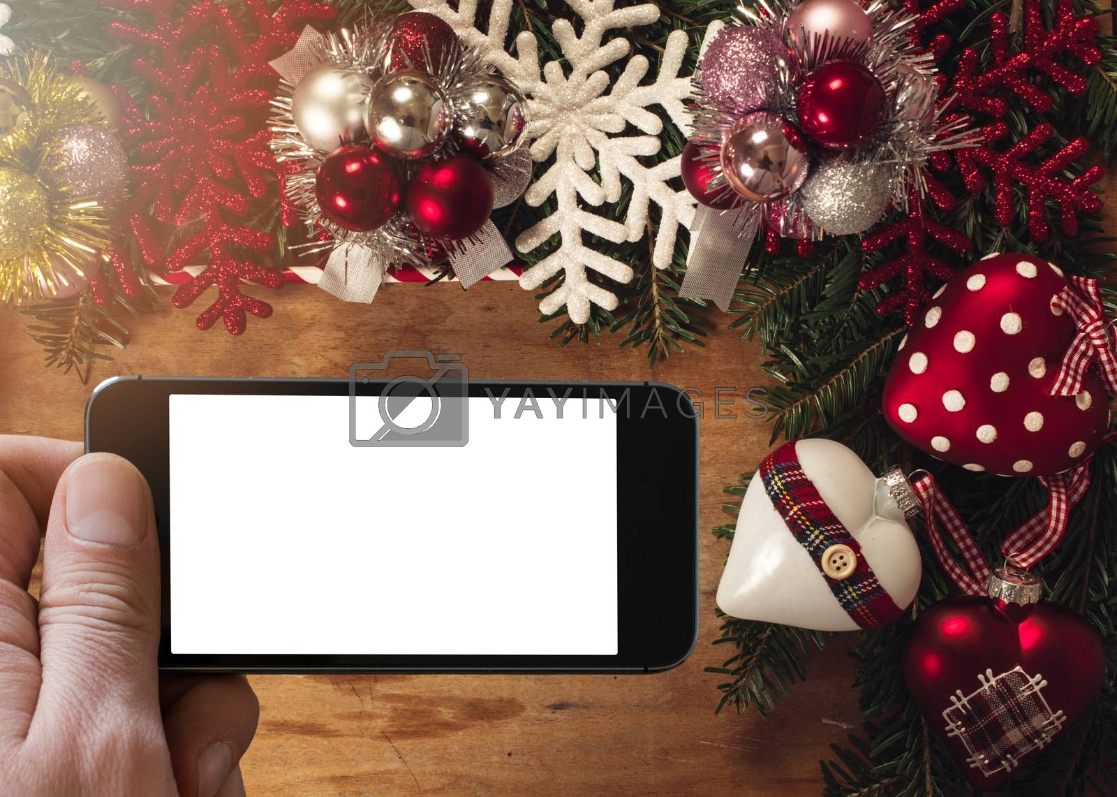 Blank space on smart phone screen in the middle of Christmas decoration
