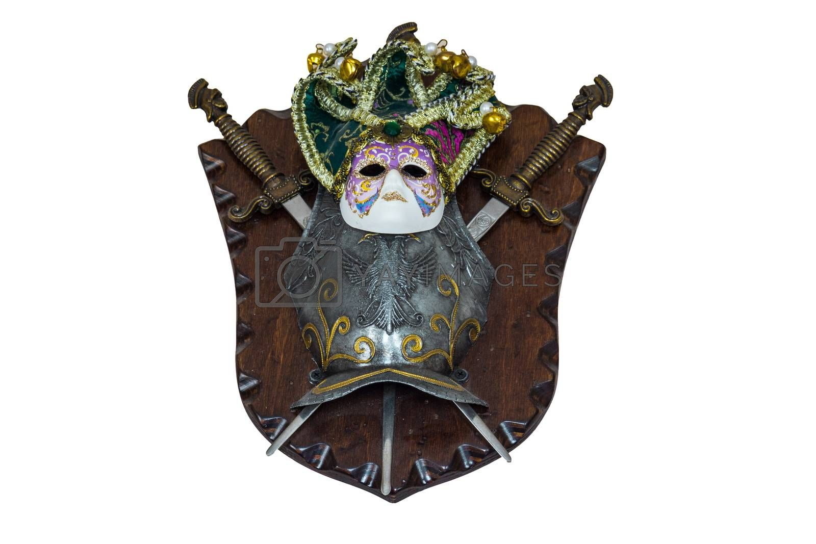 The photo shows a mask, shield and swords