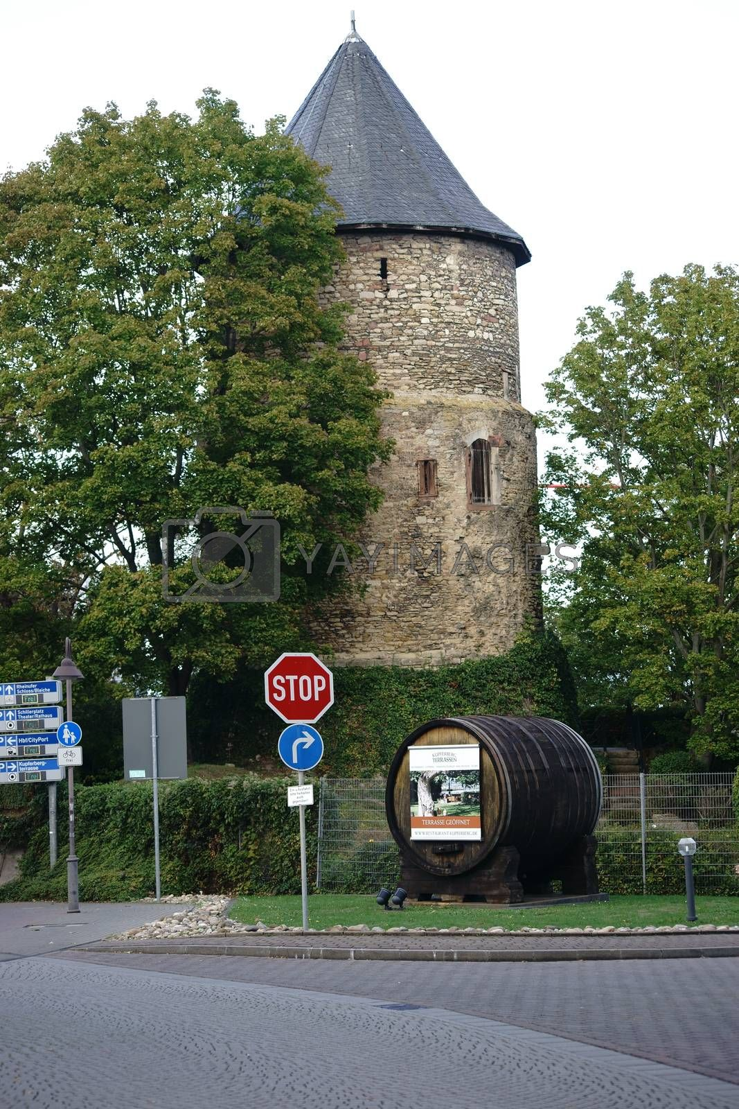 Mainz, Germany - September 19, 2015: The historic tower on the mountain terraces with a wine Copper Barrel before his entrance on September 19, 2015 in Mainz.