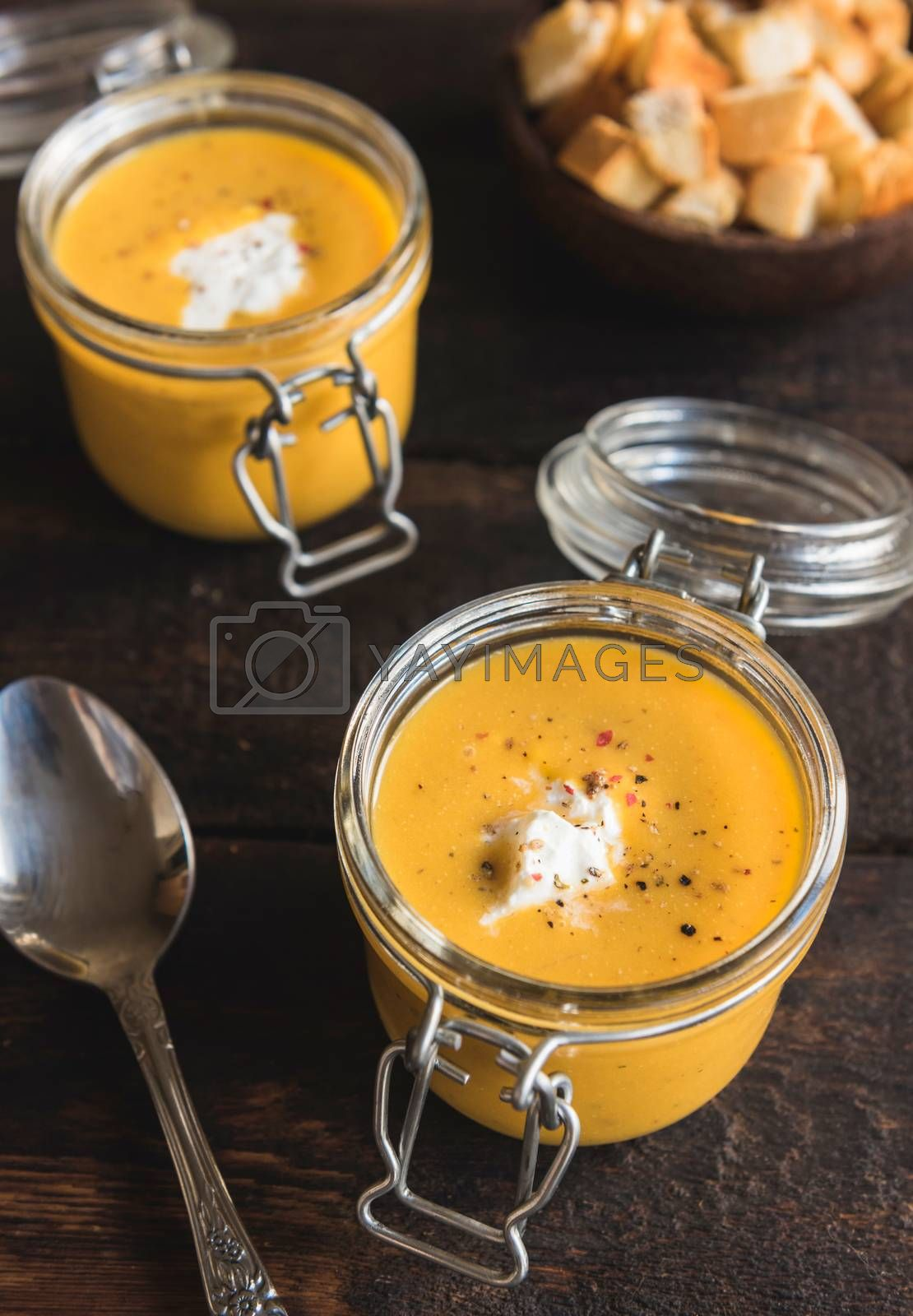 Healthy homemade pumpkin soups in the jars, selective focus