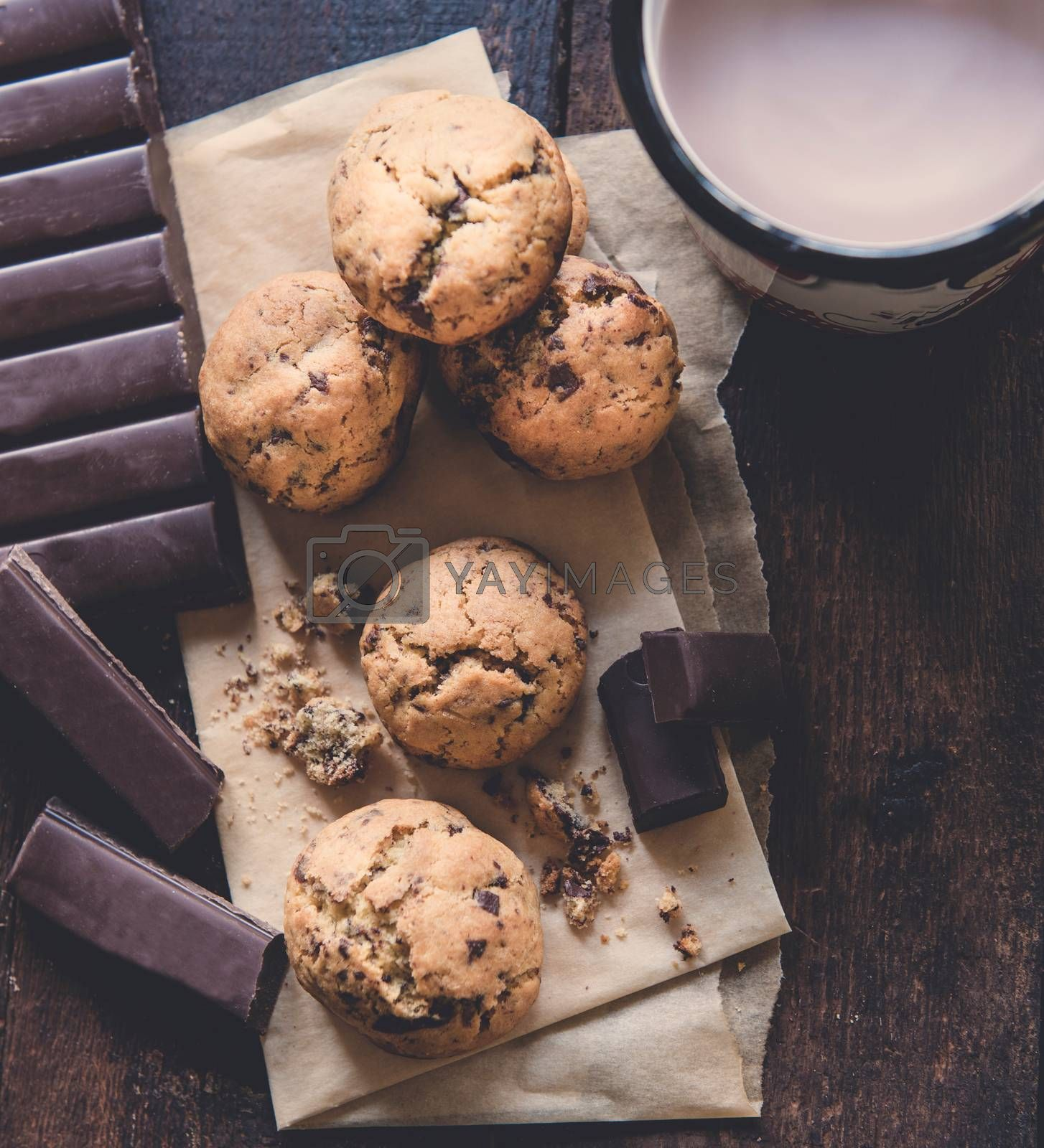 Mini homemade chocolate chip cookies in wooden bowl, selective focus