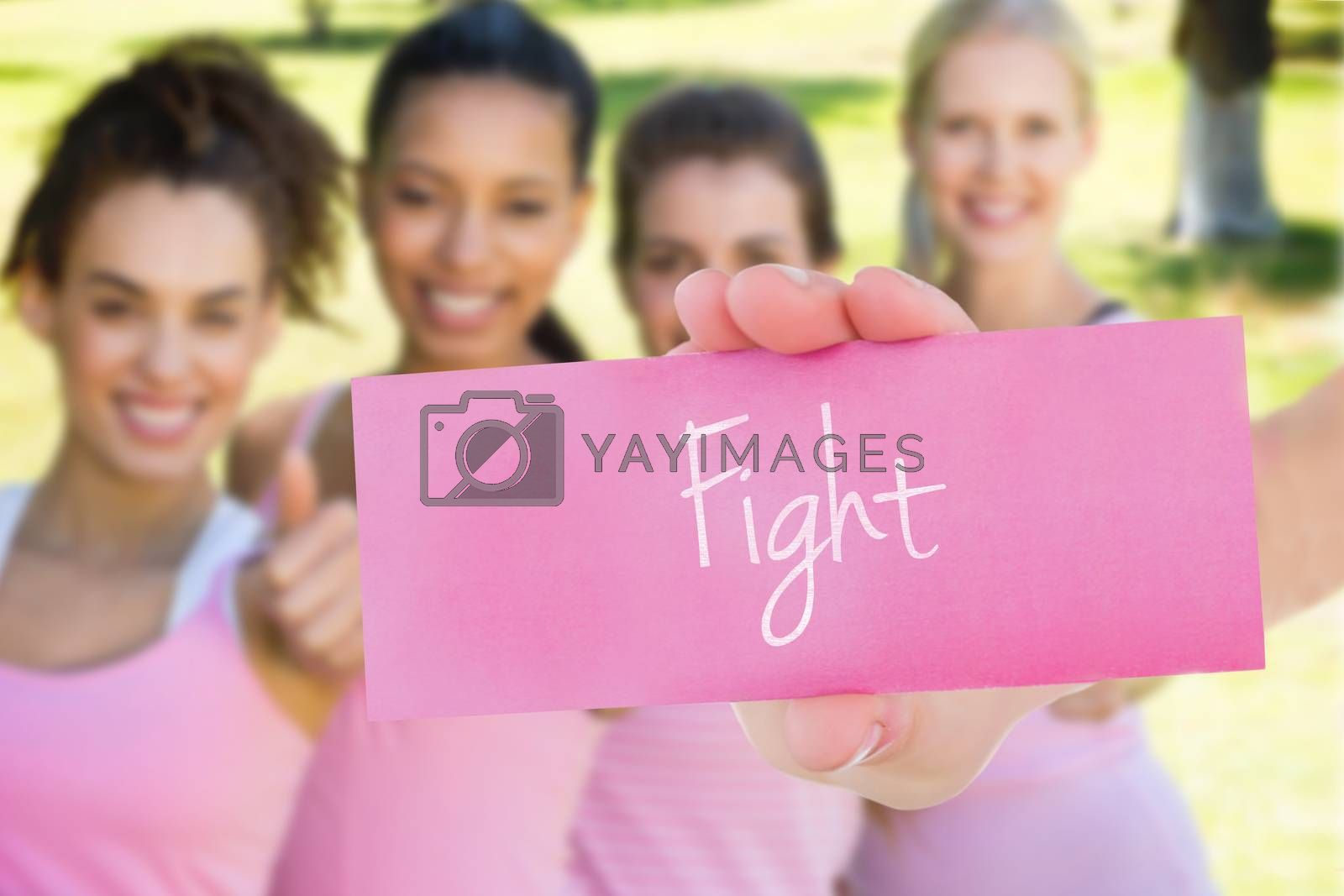 The word fight and young woman holding blank card against smiling women in pink for breast cancer awareness