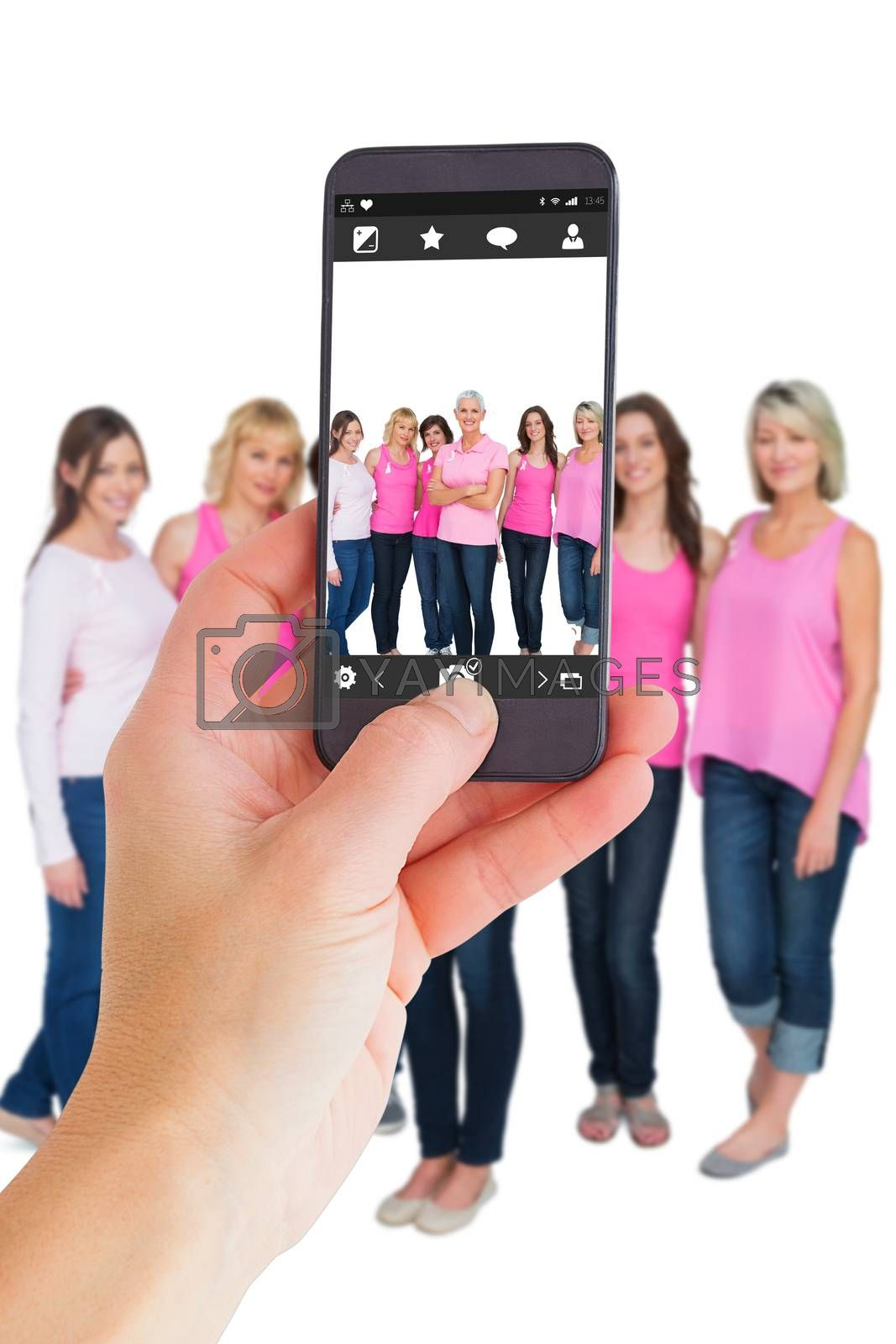 Female hand holding a smartphone against camera