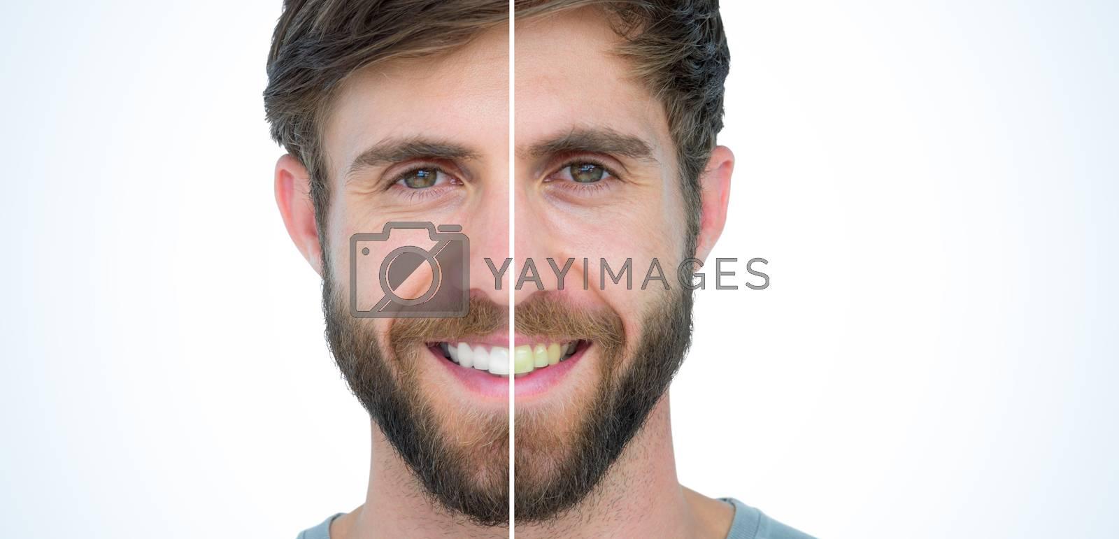 Happy handsome man looking at camera  by Wavebreakmedia