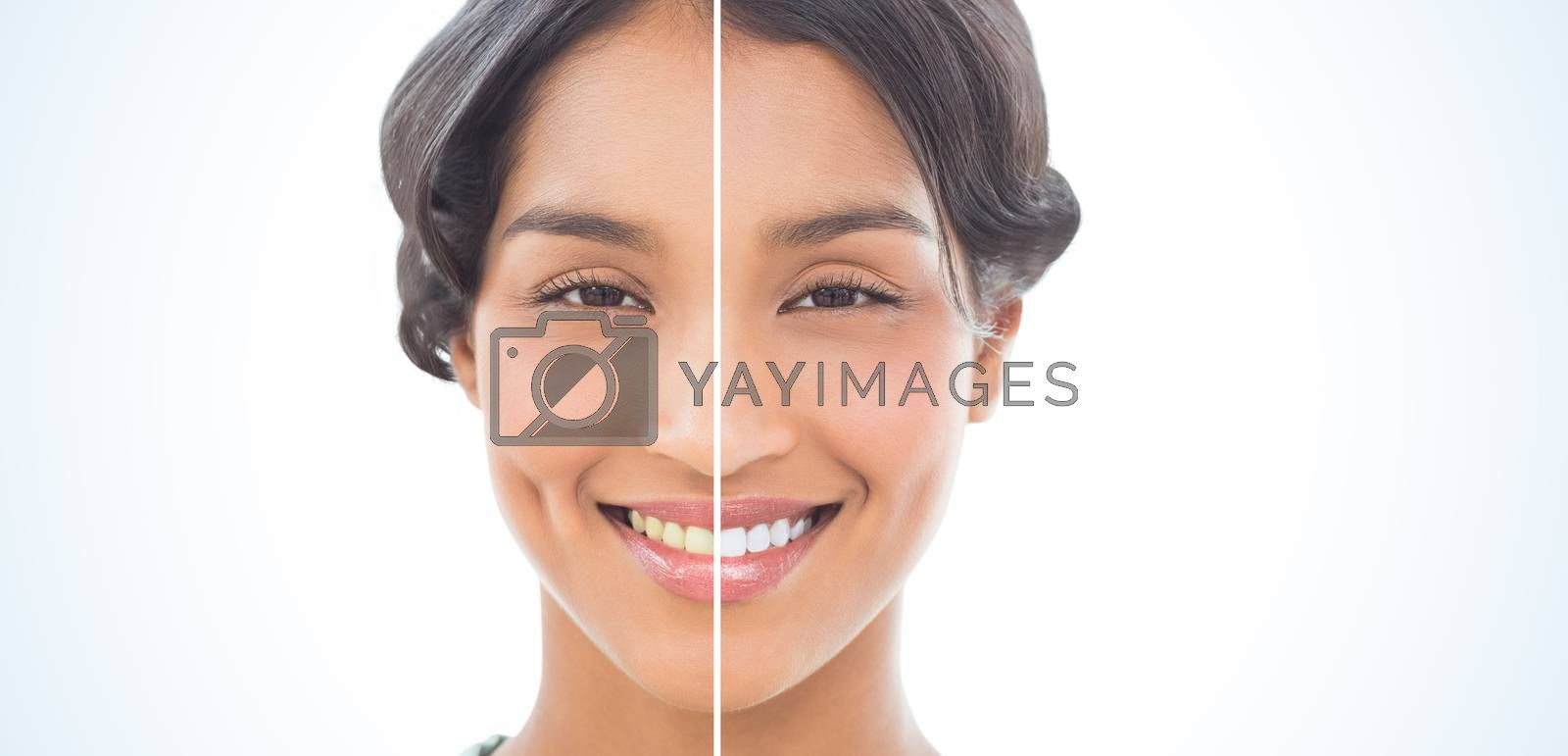 Close-up portrait of beautiful woman smiling over white background