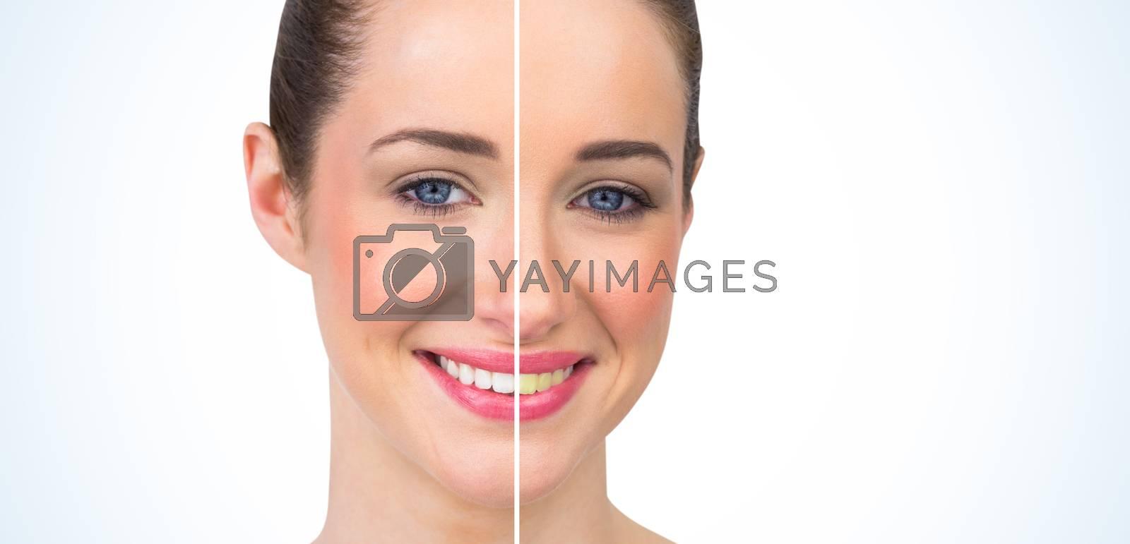 Beautiful brunette smiling at camera by Wavebreakmedia