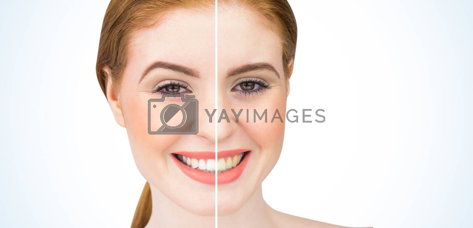 Beautiful redhead smiling at camera on white background