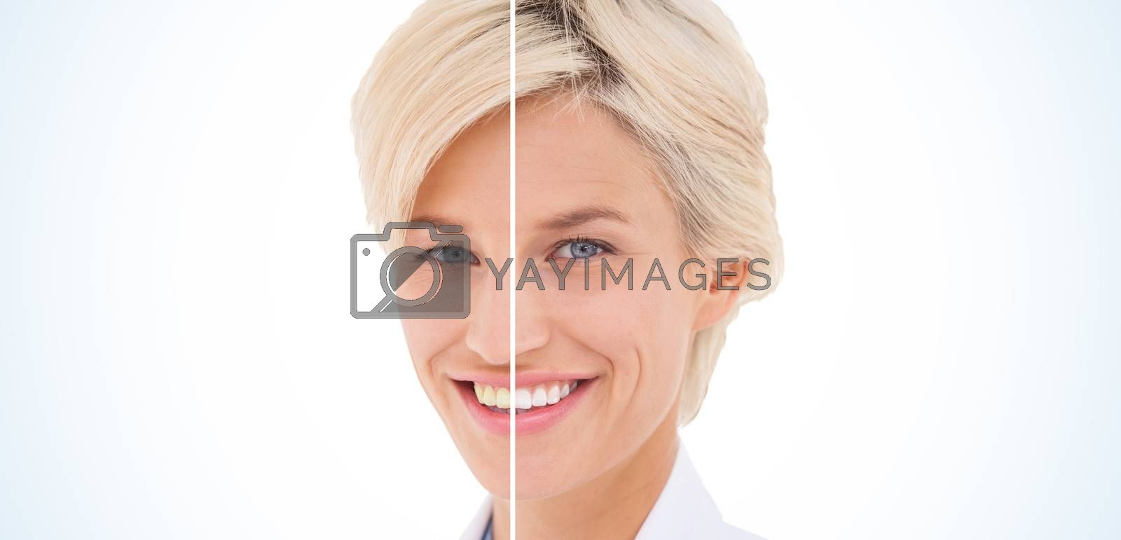 Blonde doctor smiling at camera on white background