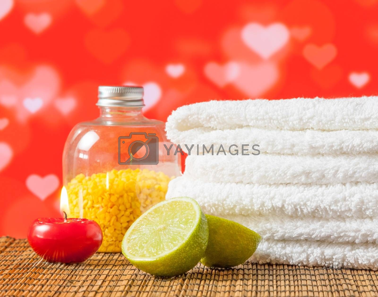 Spa massage border with towel stacked red candle and lime for valentine day by donfiore
