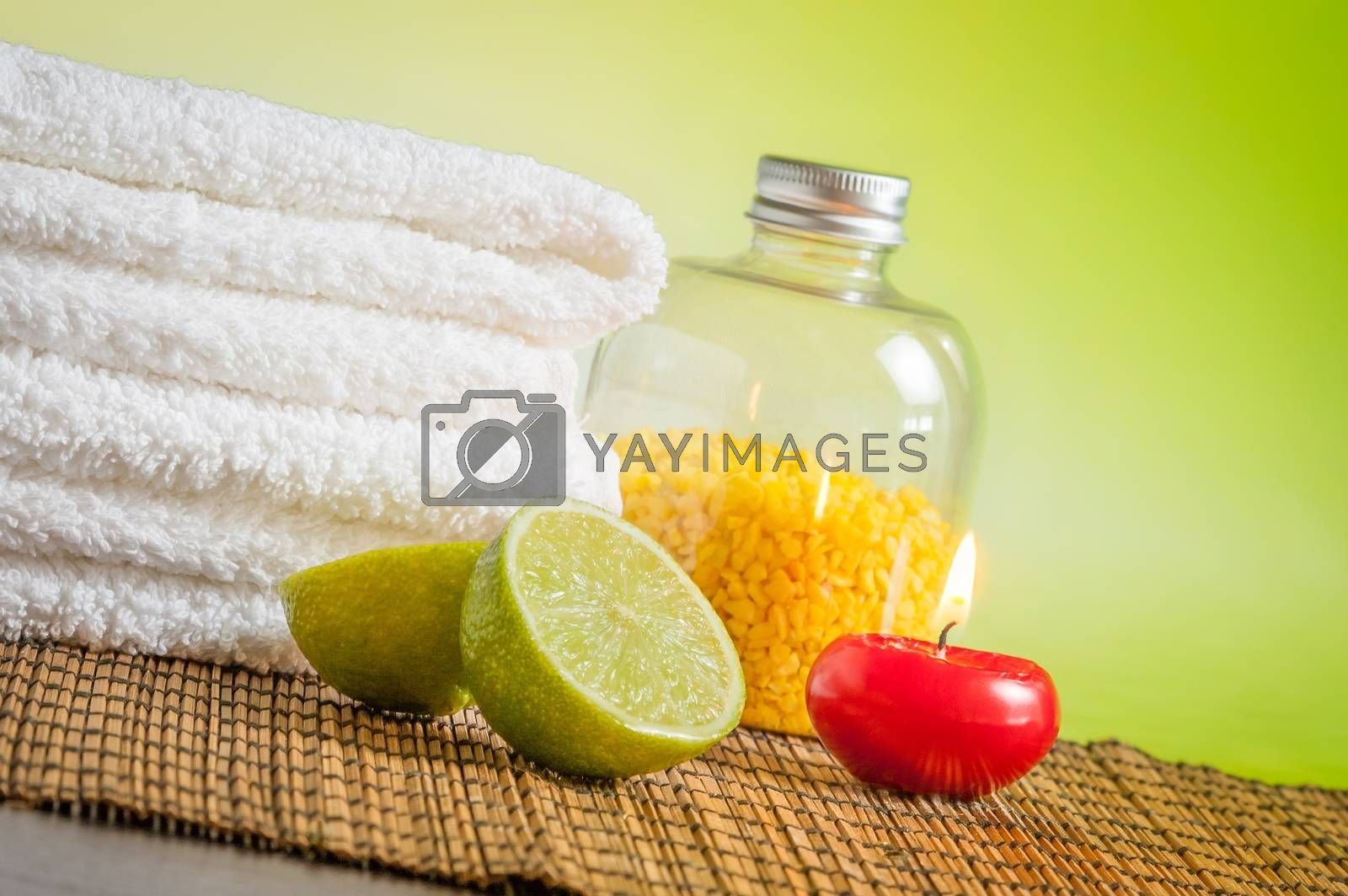 Spa massage border background with towel stacked red candle and lime by donfiore