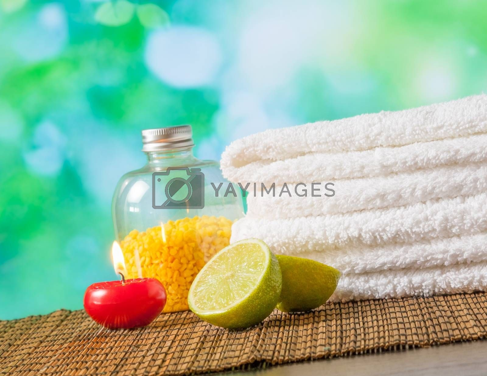 Spa massage border background with towel stacked,red candle and lime by donfiore