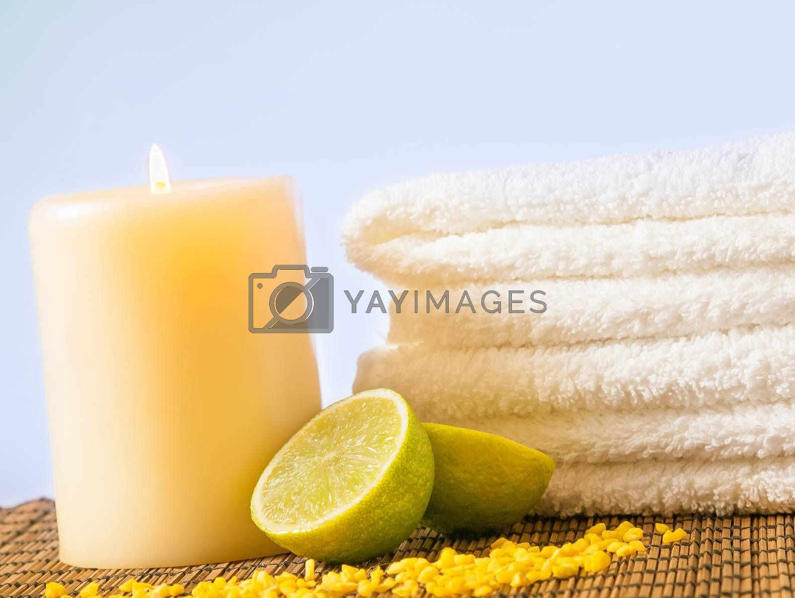 Spa massage border background with towel stacked and lime by donfiore
