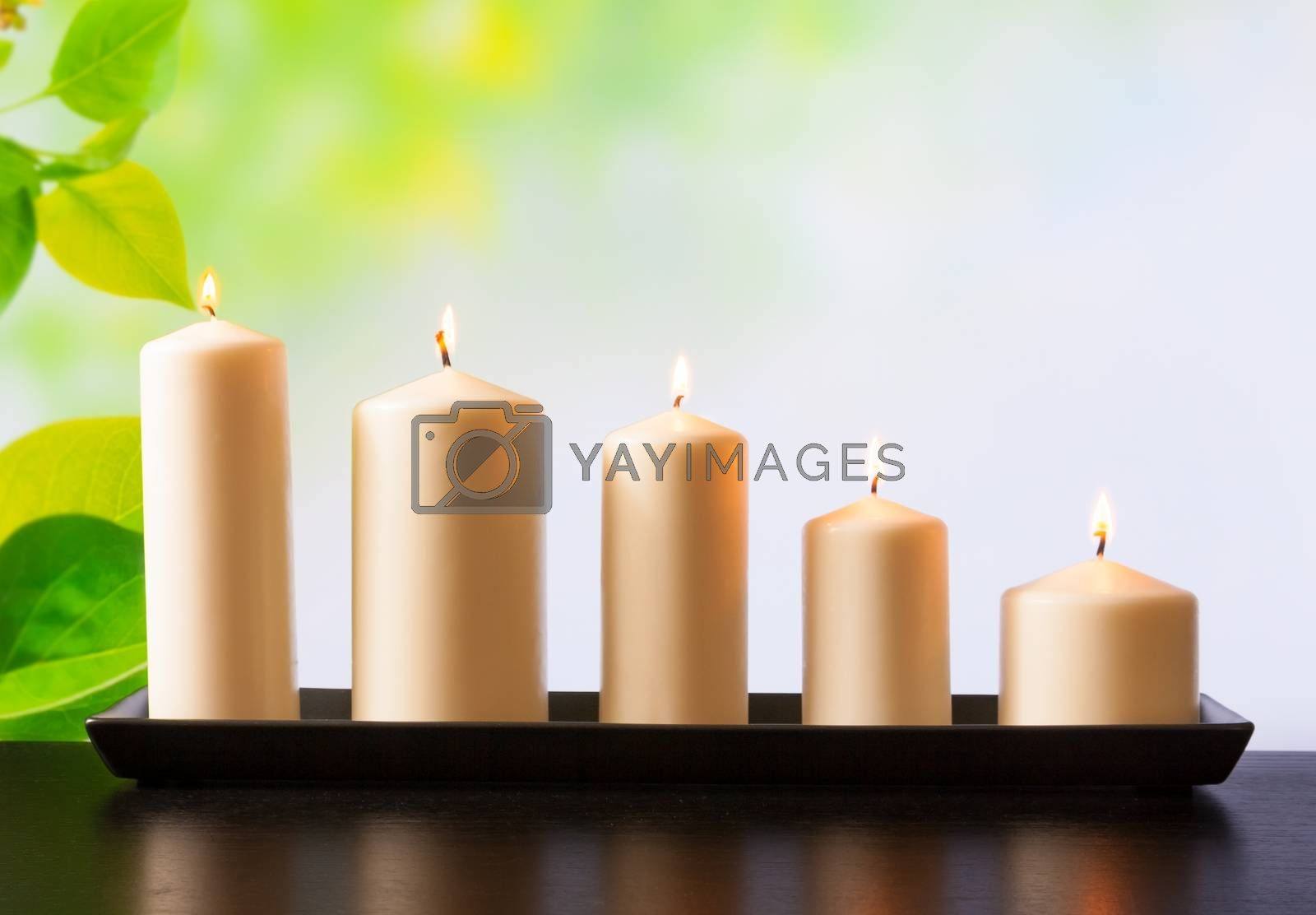 white candles on wood table by donfiore