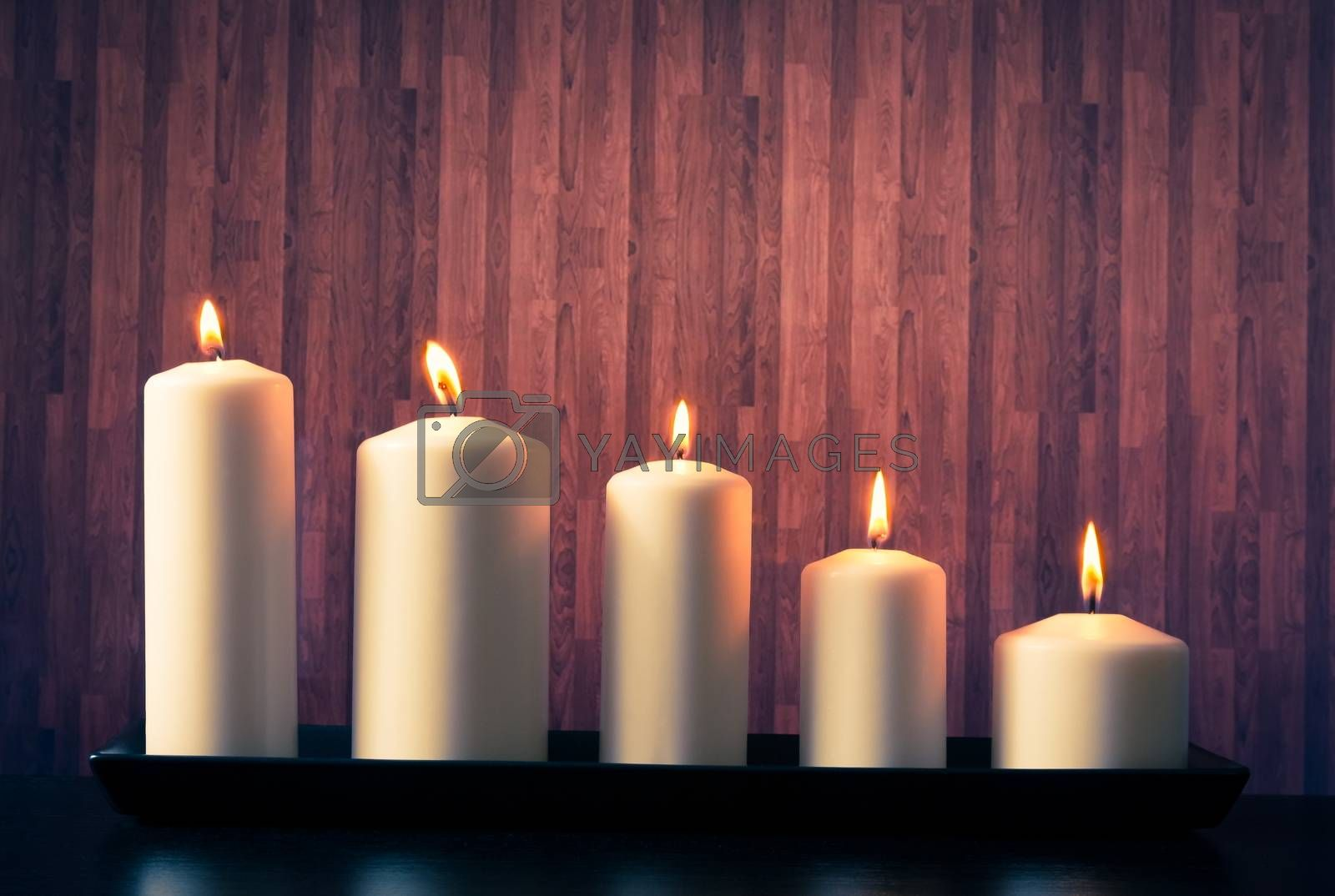 white candles on warm atmosphere  by donfiore