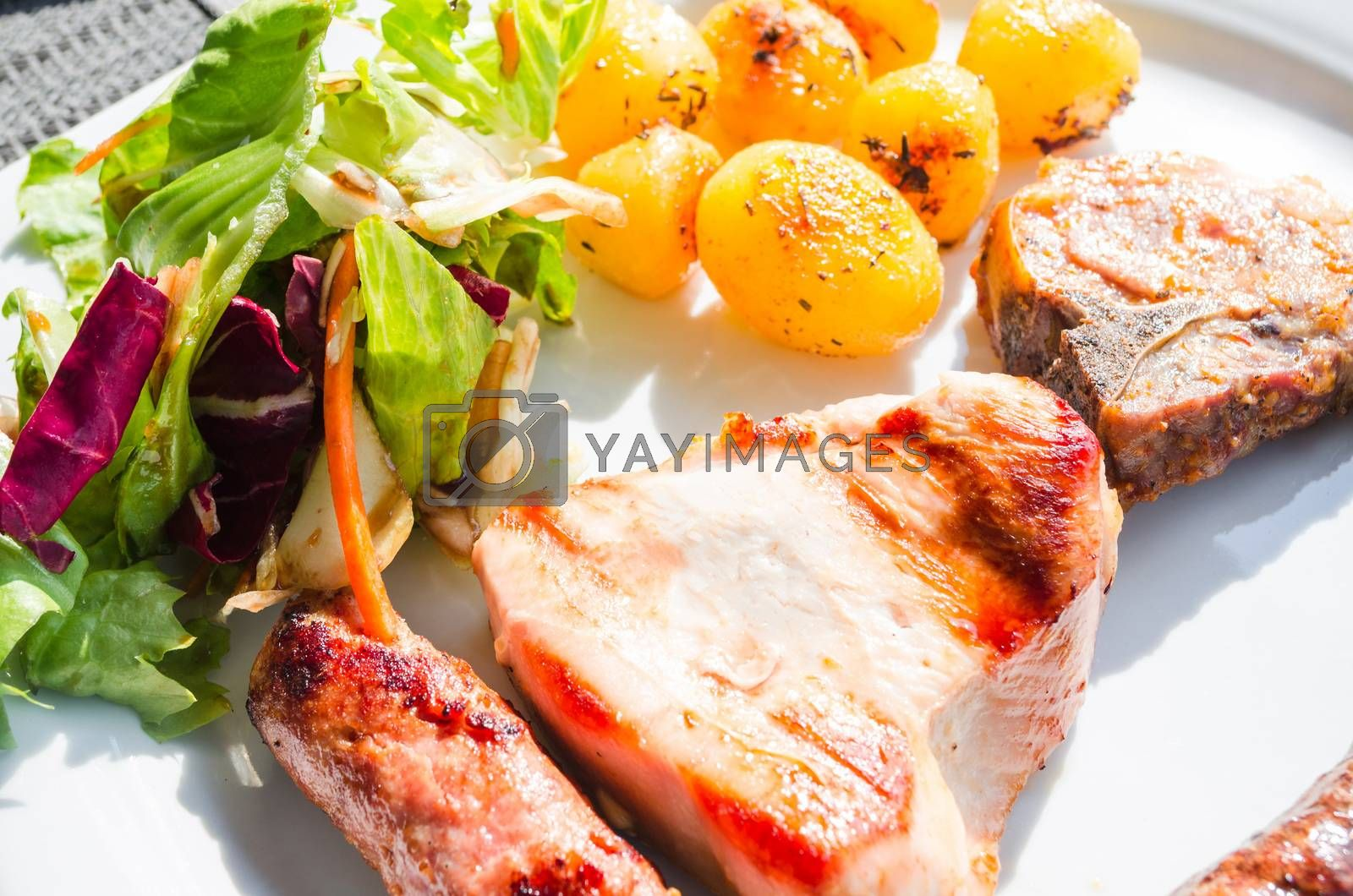 Meat, fried potatoes and salad.    by JFsPic