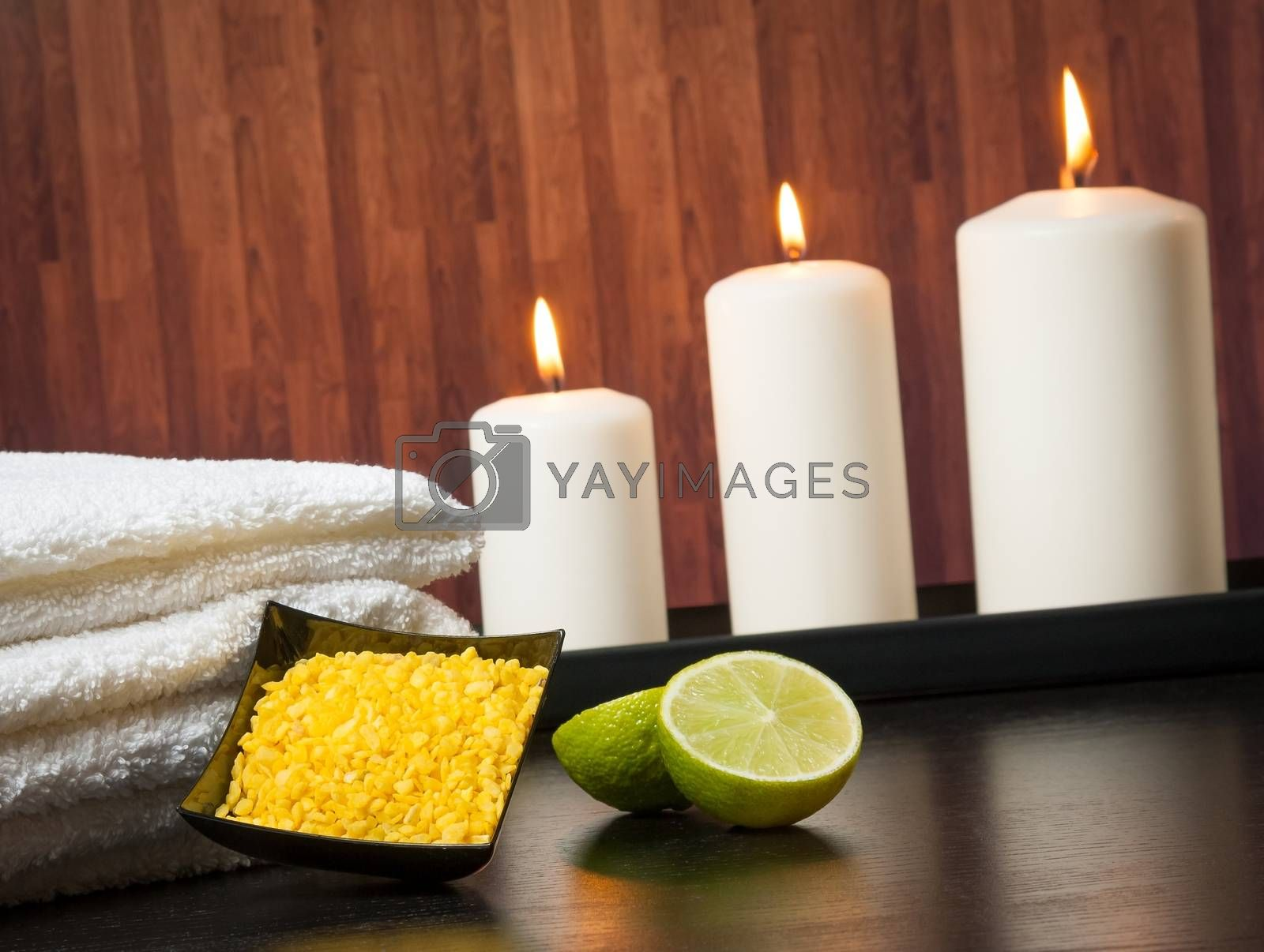 Spa massage border background with towel stacked candles and sea salt by donfiore