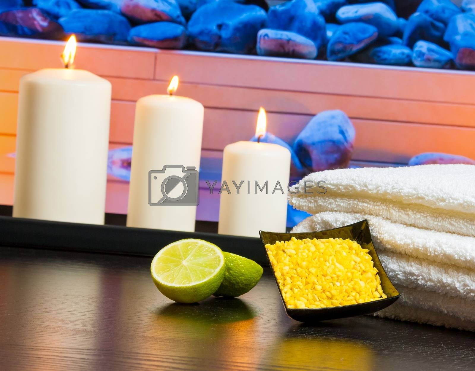 Spa massage border background with towel stacked candles sea salt and lime by donfiore