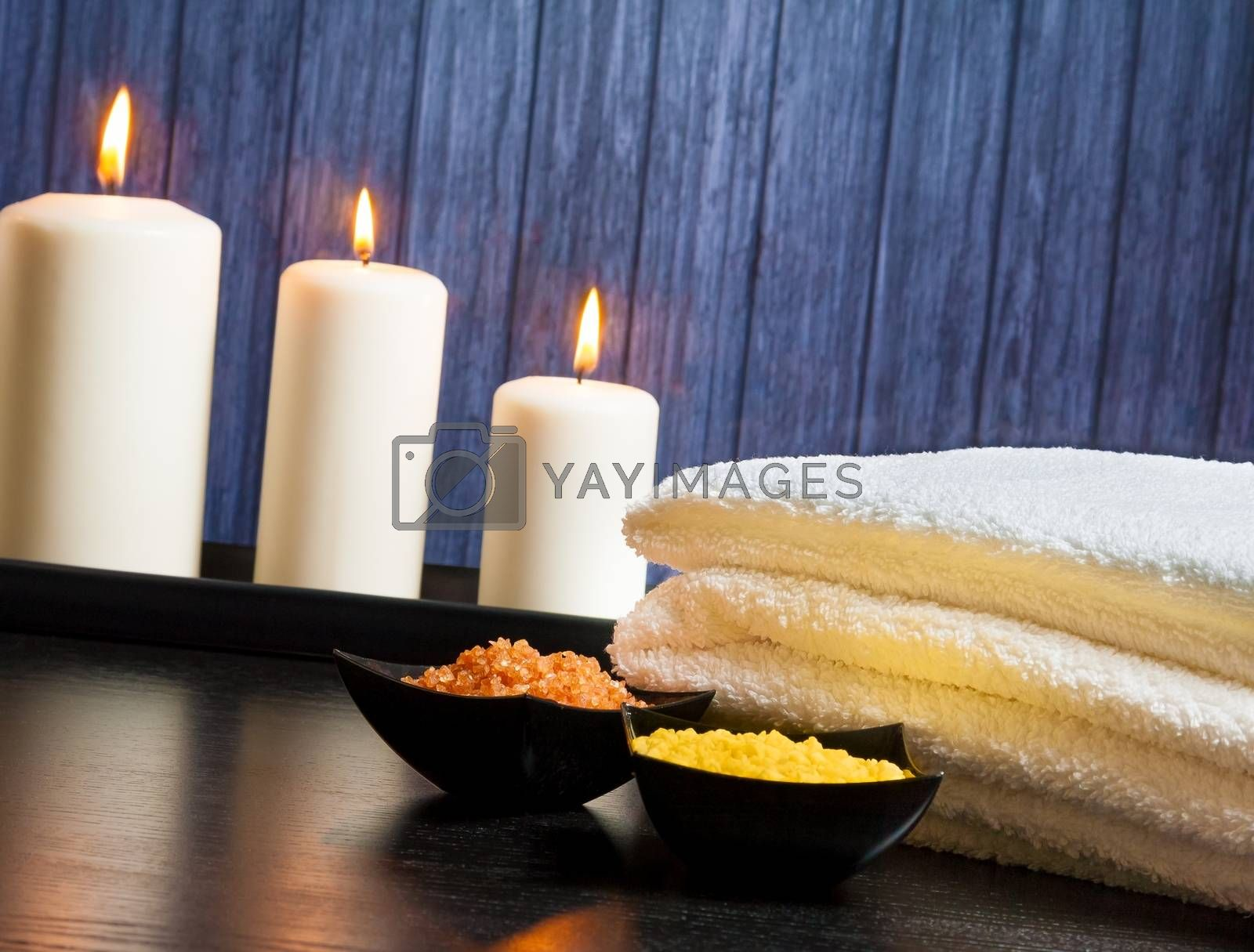 Spa massage border background with towel stacked.candles and sea salt by donfiore